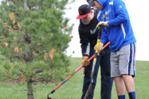 Central students planting a tree as part of Service Day.