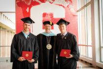 Central College President Mark Putnam poses for a photo with the first two graduates of Central's engineering program.