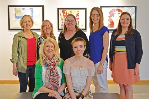 From left to right, front row to back row: Lynn Hinga Branderhorst '79, Callie Gardeman '18, Ann Hinga Klein, Professor of Chemistry Cathy Hinga Haustein '76, Professor of Art Treva Reimer, Michelle Stam and Sarah Purdy '16.
