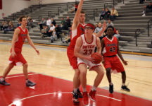 Central's Thomas Spoehr working under the basket in a game against Grinnell College.