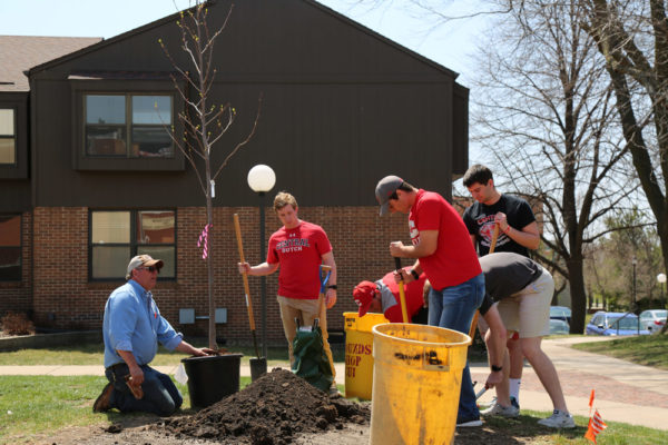 Students planting a tree on Arbor Day 2018