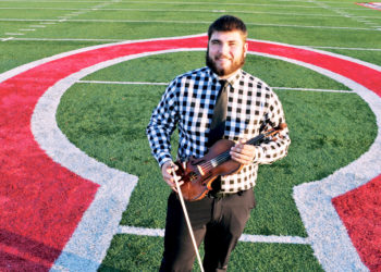 "Ed Henning '20 grew up on a farm near Hartwick, Iowa, population 79. He appreciates he can continue to play both classical violin and football at Central. ""Every college you visit, they all say they're like a family. But Central was the only one that really felt like that,"" he says."
