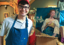 Brandon Rosas '20 with one of the paintings he produced over the summer.