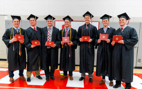 Seven members of the Class of 2019 pose for a group photo following their commencement ceremony.