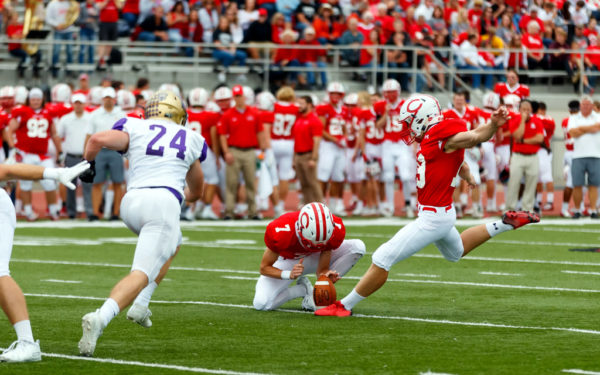 Jon Alberts '20 kicking a field goal during a game against Loras College.