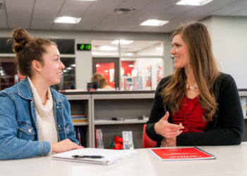 Director of Career and Professional Development Jessica Klyn de Novelo '05 (right) meeting with a student.