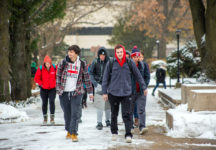 Students walking on Peace Mall during snowy weather.
