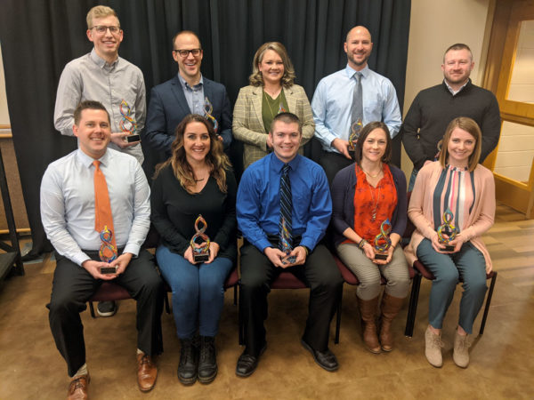 Dan Huitink '04 (back row, second from left), Brent Gaulke '02 (front row, far left), Hannah Wallace Vander Veer '16 (front row, far right) and Kris Wolthuizen Van Gent '15 (back row, far left)