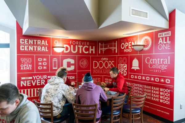 Students eating in Central Market, alongside recently installed artwork.
