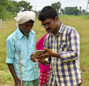 Two men making use of the Cadasta mobile app