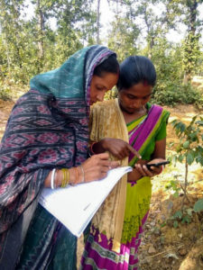 Two women using the Cadasta mobile app