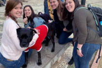 Laurynn Mize '21 and other students posing for a photo with a dog