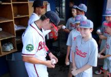 Garrett Saunders '19 signs a young fan's ball.