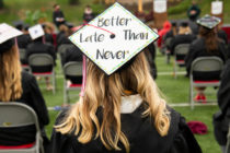 """2020 Central graduate with """"Better Late Than Never"""" on her mortarboard."""