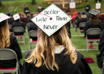 "2020 Central graduate with ""Better Late Than Never"" on her mortarboard."