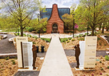 A memorial to Central's veterans flanks the college's new Peace Mall history garden and Wallace Spencer Stepenske '64 Amphitheater