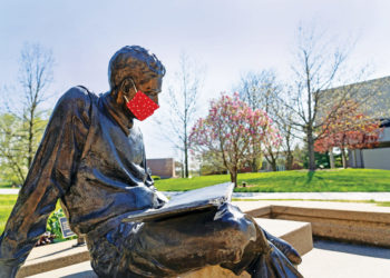 A thoughtful Central community member fitted The Quest, Central's bronze likeness of Harold Geisler, with a mask while studying and practicing physical distancing on the Peace Mall.