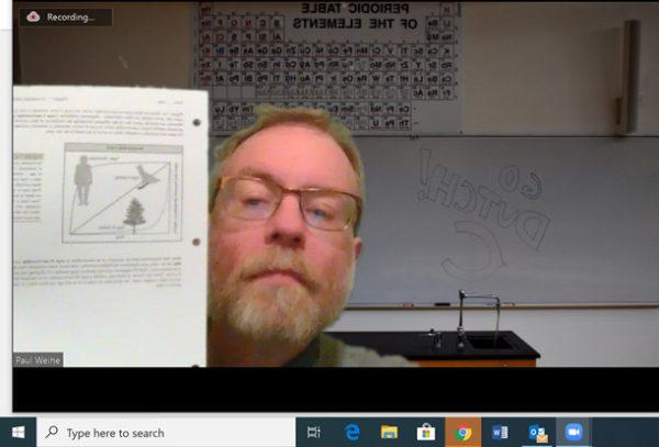 Paul Weihe, associate professor of biology, leads a class session using Zoom.