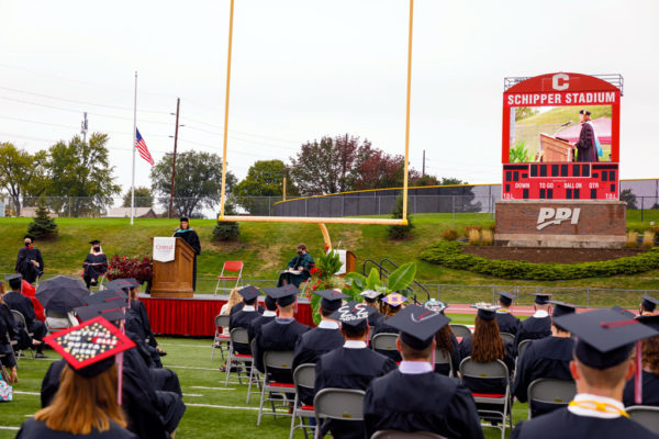Students from the Class of 2020 look on as Kellie Gorsche Markey '88 addresses them during her Commencement speech in September.