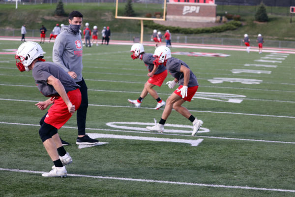 Football practice at Central in a pandemic meant face masks and small-group workouts, like Assistant Coach Austin Mercer put his cornerbacks through.