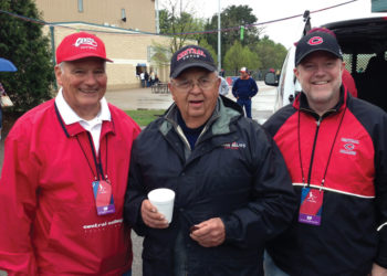 Former Central presidents David Roe (left) and President Emeritus Ken Weller (center) join current President Mark Putnam at the 2013 NCAA Division III softball championships in Eau Claire, Wisconsin.