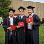 Three Class of 2021 graduates posing for a photo