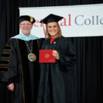 President Mark Putnam poses with a graduate of the Class of 2021