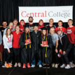Members of the Central College Track and Field team posing with senior members at a special Commencement ceremony for the athletes