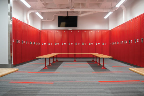 Bold, red lockers featuring the athletics logo greet Dutch athletes in the locker rooms.