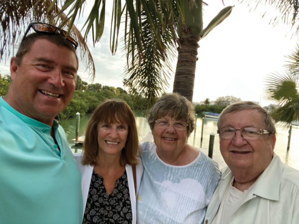 Brad Depke '82 (left) and wife Jan (second from left) with Art (right) and Diane Alt (second from right) in Florida in February 2021.