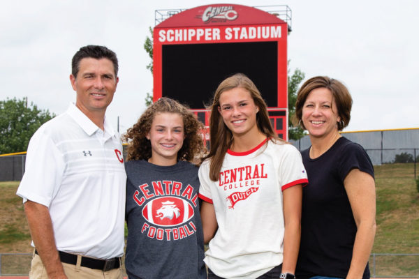 Jeff McMartin'90,(left), along with his daughters, Emily and Caroline '24, and wife Laurie Rieken McMartin '90.