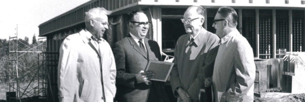 Pictured above are, left to right, former Board of Trustees chair Jack Boatsma, President Emeritus Ken Weller, P.H. Kuyper and former board secretary Paul Farver.