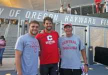 """Jim Fuller, associate head men's and women's track coach (right), Kurtis Brondyke '11 (center) and Will Daniels '19 enjoyed the thrill of hearing the words """"Central College"""" announced at events more than once during Olympic Trials this summer."""
